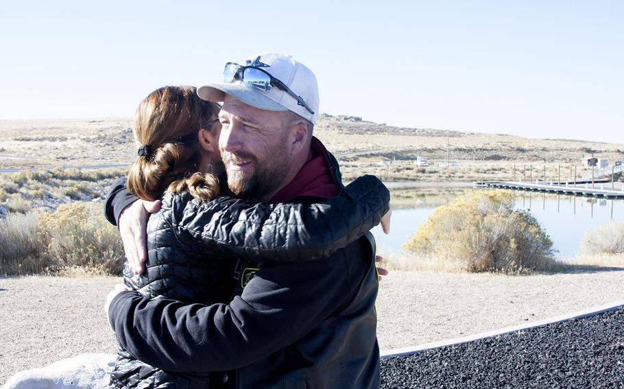 Veteran and psychologist Annabelle Bryan hugs Kelley Bunten, a member of the Combat Veterans Motorcycle Association, on Saturday, Oct. 28 at Antelope Island State Park in Utah. The association raised $35,000 through their Ride to Zero initiative for the National Center for Veterans Studies to help fund suicide-prevention efforts.