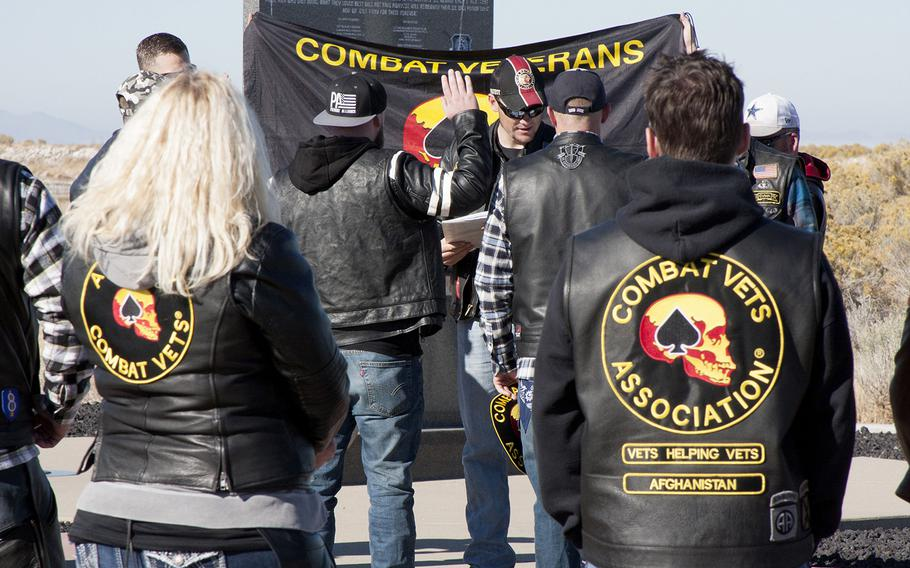 A Utah chapter of the Combat Veterans Motorcycle Association swears in a new member Saturday, Oct. 28 at Antelope Island State Park, where they awarded the National Center for Veterans Studies $35,000 to fund suicide-prevention research.