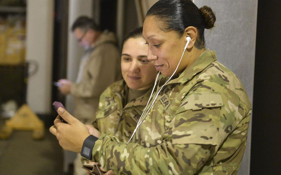 Sgt. Vanessa Turner chats with her 4-year-old son via a smartphone video calling app at a coalition base at the international airport in Irbil, Iraq, on Sunday, Dec. 25, 2016.