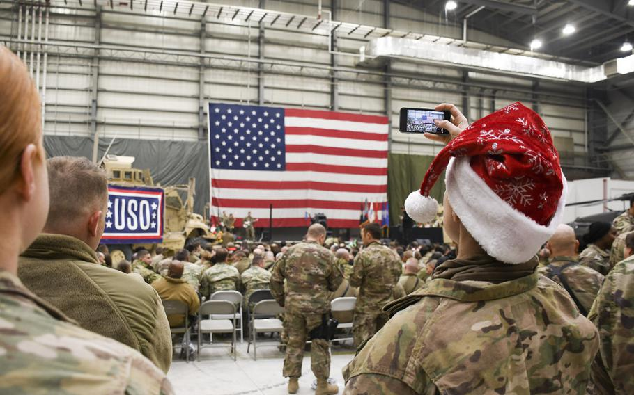 Tech. Sgt. Tarah White takes a video on her smartphone during a Christmas Eve USO show at Bagram Air Force Base on Sunday, Dec. 24, 2017.