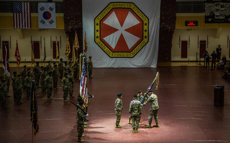 In his final act as 8th Army commander, Lt. Gen. Thomas Vandal passes the unit's colors at Camp Humphreys, South Korea, Friday, Jan. 5, 2018.