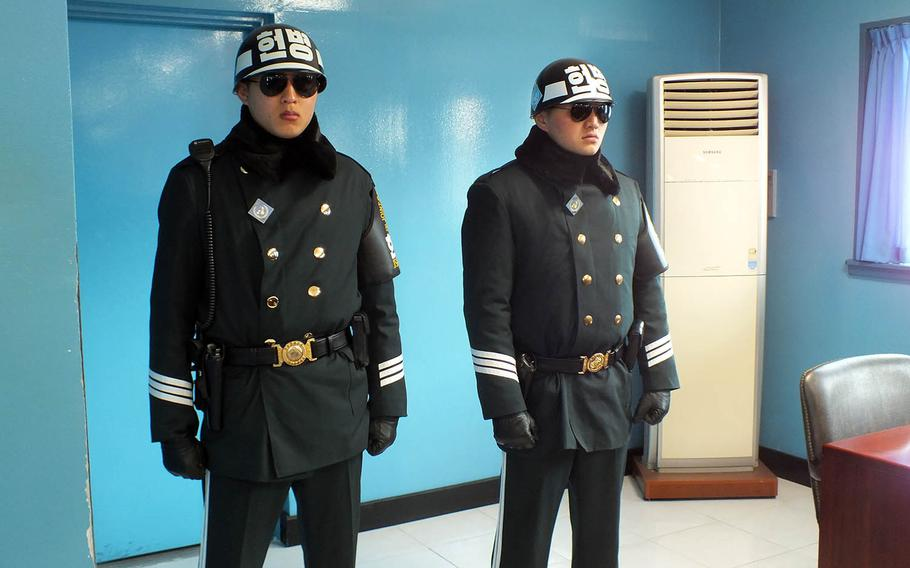 South Korean soldiers stand guard last year inside a conference room at the Joint Security Area of the Demilitarized Zone.