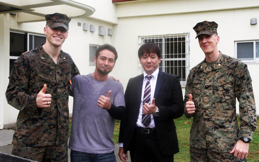 From left to right, Marine 1st Lt. Aaron Cranford, Justin Kinjo, Yusuke Teruya and Maj. John Mahler pose at Camp Schwab, Okinawa, after Cranford received the Navy and Marine Corps Medal, Monday, Jan. 8, 2017. Cranford saved Kinjo, Teruya and two others from drowning in April 2017.