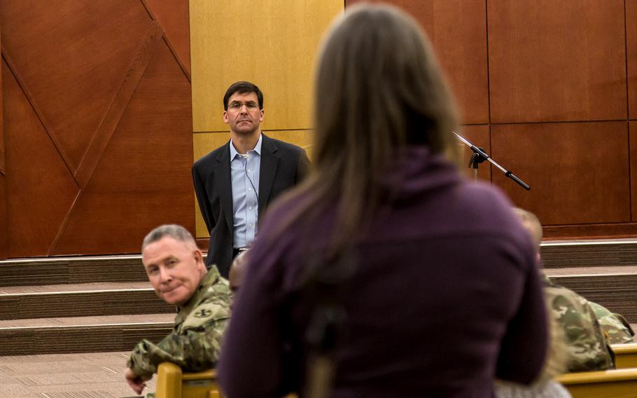 Secretary of the Army Mark Esper and 8th Army commander Lt. Gen. Michael Bills listen to a question from a civilian at Camp Humphreys, South Korea, Tuesday, Jan. 9, 2018.