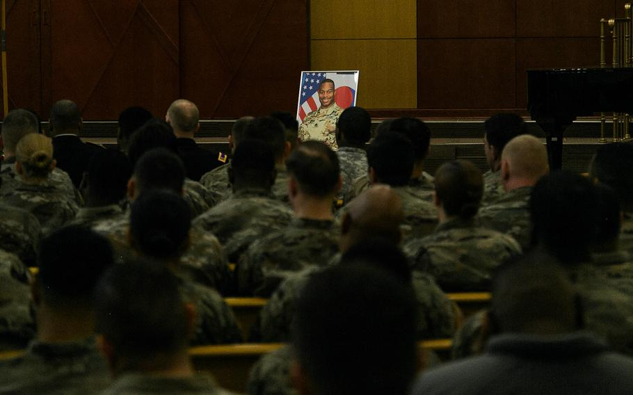 A portrait of Staff Sgt. Kyle LeFlore overlooks his former comrades during a ceremony at Camp Humphreys, South Korea, Thursday, Jan. 11, 2018.