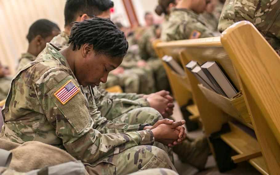 A soldiers grieve during a memorial service for Staff Sgt. Kyle LeFlore at Camp Humphreys, South Korea, Thursday, Jan. 11, 2018.