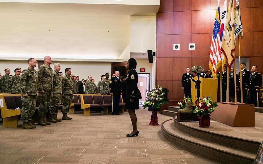 1st Sgt. Devon Legare calls Staff Sgt. Kyle LeFlore a final time during a ceremonial final roll call at Camp Humphreys, South Korea, Thursday, Jan. 11, 2018.