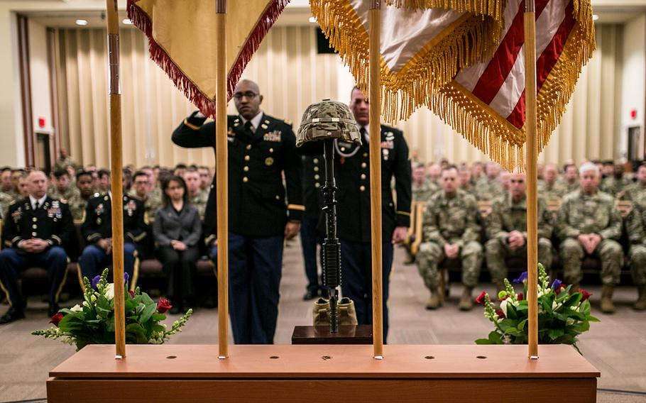 Chief Warrant Officer 2 Daniel Robinson, left, and Sgt. Ryan McChesney salute the soldier cross representing Staff Sgt. Kyle LeFlore at Camp Humphreys, South Korea, Thursday, Jan. 11, 2018.