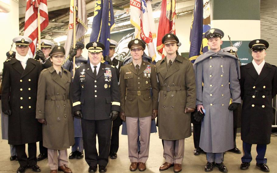 Army Chief of Staff General Mark Milley stands with Sergeant Major of the Army Dan Dailey prior to walking out onto the field for the beginning of the Army-Navy game in Philadelphia, December 9, 2017. Standing with them in front of the games color guard were soldier models who along with the SMA are wearing the proposed Pink & Green daily service uniform.