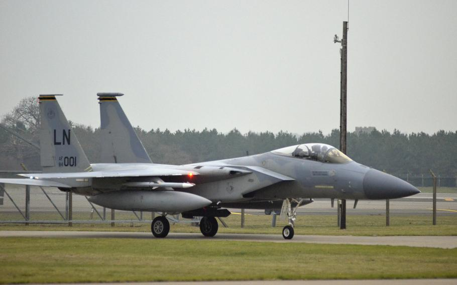 """Capt. """"Nacho"""" Taylor taxis in an F-15C Eagle after returning to RAF Lakenheath, England, from a NATO Baltic air-policing rotation at Siauliai Air Base in Lithuania, Tuesday, Jan. 9, 2018."""