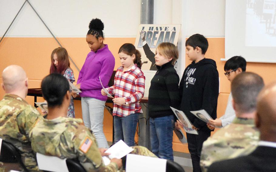 Children from the Vilseck Elementary School in Germany recite poems inspired by Martin Luther King Jr. at a ceremony honoring the late civil rights leader, Thursday, Jan. 11, 2017.