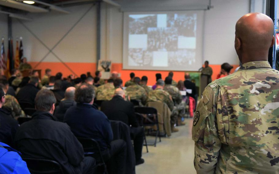 Equal opportunity leader Sgt. 1st Class Rashaad Liban listens as soldiers speak about the civil rights movement at an event marking the birthday of Martin Luther King Jr., Vilseck, Germany, Thursday, Jan. 11, 2017.