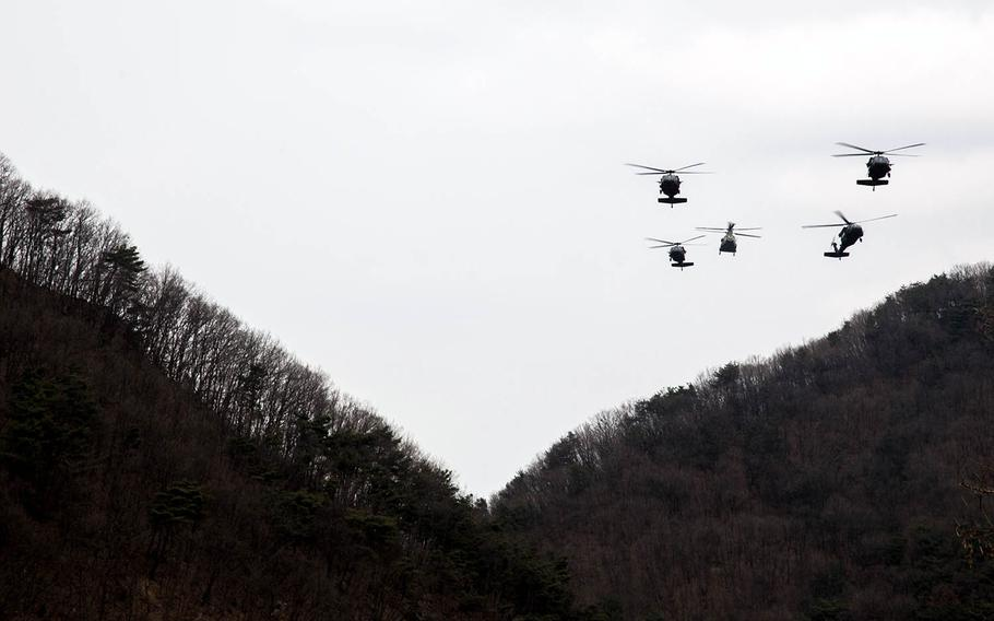 Army helicopters fly over Rodriguez Live Fire Range in Paju, South Korea, Tuesday, March 21, 2017.