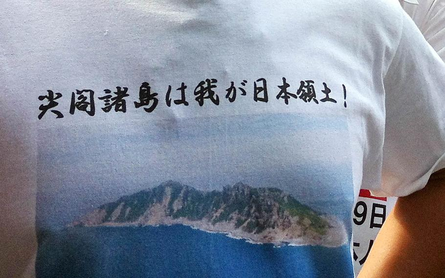 A man wears a T-shirt that says the Senkakus belong to Japan, during a past demonstration over the disputed East China Sea islands.