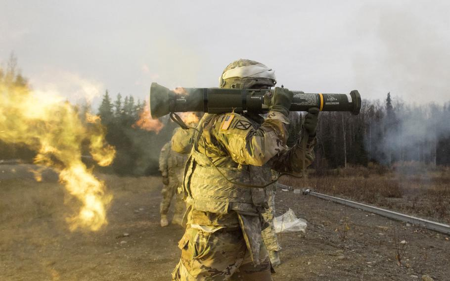 A soldier handles an AT-4 light anti-armor weapon during live-fire training at Joint Base Elmendorf-Richardson, Alaska, Oct. 12, 2017.
