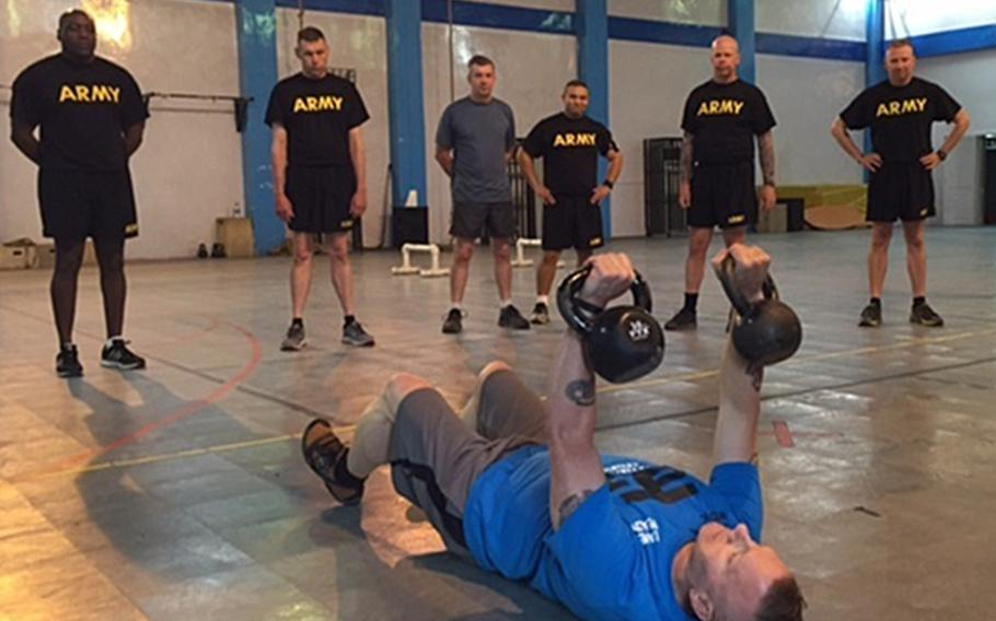 Army Command Sgt. Maj. John Wayne Troxell, the senior enlisted advisor to the chairman of the Joint Chiefs of Staff, leads an intense, early morning workout session at Resolute Support headquarters in Kabul, Afghanistan, July 17, 2016.