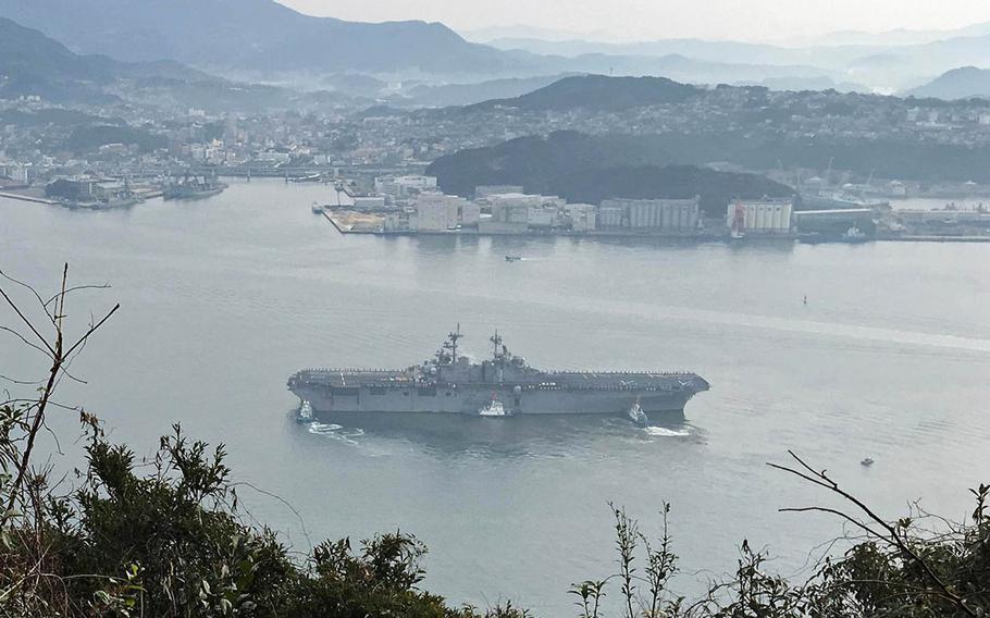 The amphibious-assault ship USS Wasp arrives at Sasebo Naval Base, Japan, Sunday, Jan. 14, 2018.