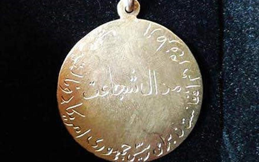 Pictured here in an undated photo is a $650 gold medal for bravery that a community in Logar province, Afghanistan, presented to the U.S. Embassy in Kabul on behalf of President Donald Trump on Saturday, Jan. 13, 2018.