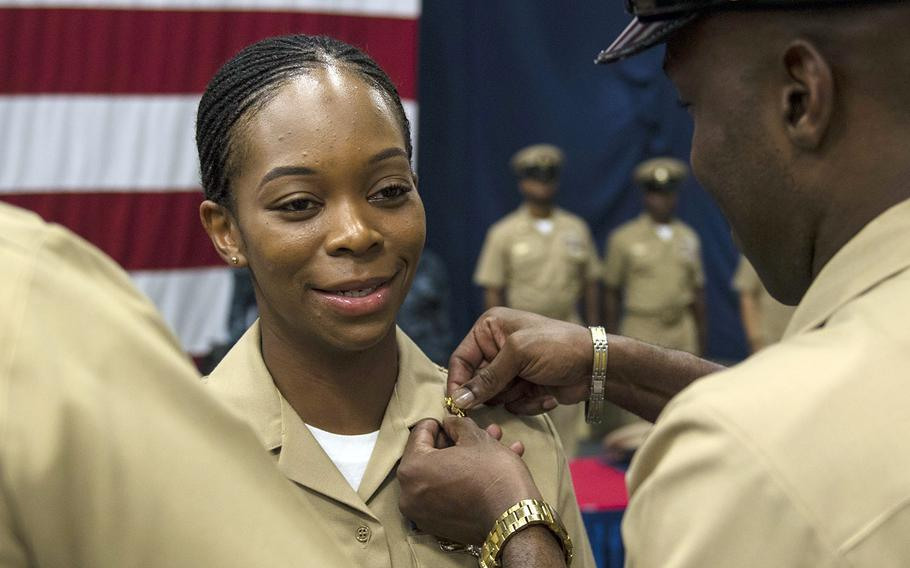 A sailor is promoted to the rank of chief petty officer during a pinning ceremony aboard the USS Iwo Jima, Sept. 16, 2017.