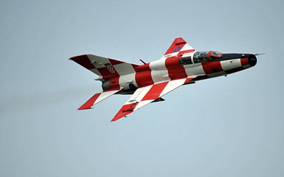 A Croatian MiG-21UM twin-seat trainer in flight. Painted in Croatia's checkerboard red-and-white pattern, the plane is one of less than a dozen MiG-21s that remain operational in Europe today.