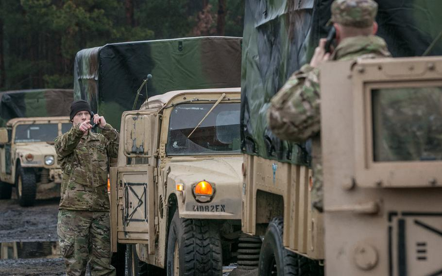 Spc. Caleb L. Gardner, left, an intelligence analyst assigned to Delta Company, 82nd Brigade Engineer Battalion, 2nd Armored Brigade Combat Team, 1st Infantry Division, Fort Riley, Kan., conducts radio checks with other vehicles within a convoy at Zagan, Poland, Jan. 11, 2018.