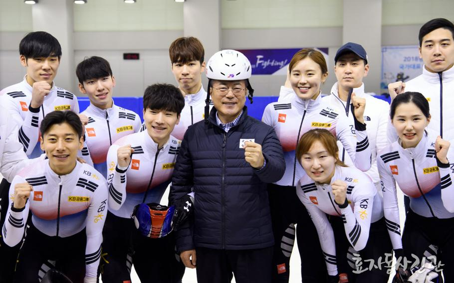 South Korean President Moon Jae-in meets with South Korean athletes at a training center in Jincheon, South Korea, Wednesday, Jan. 17, 2018.