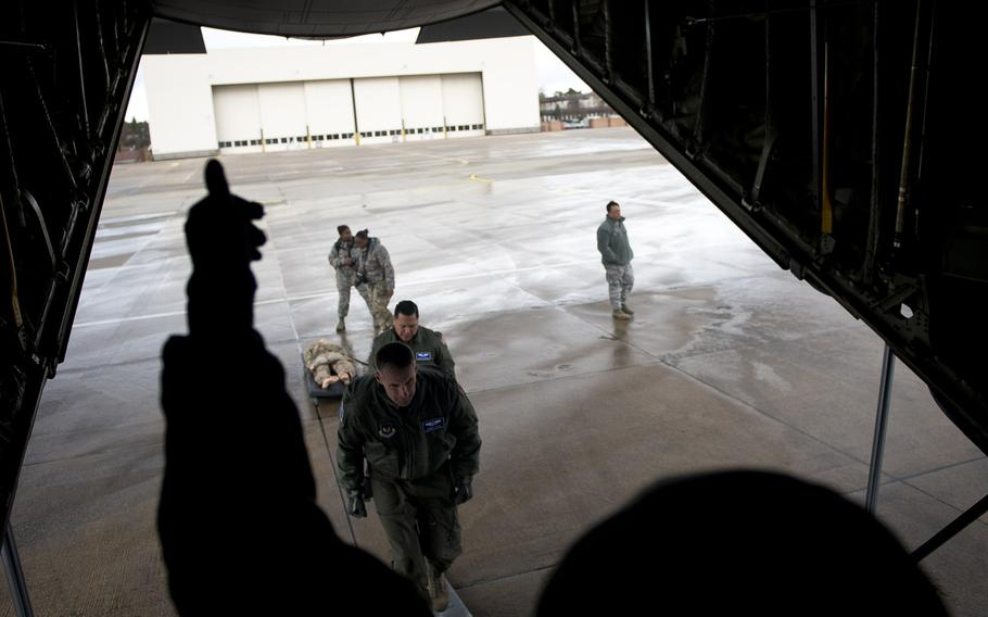 U.S. Air Force aeromedical evacuation airmen load a simulated casualty onto a C-130 at Ramstein Air Base, Germany, on Thursday, Jan. 18, 2018.