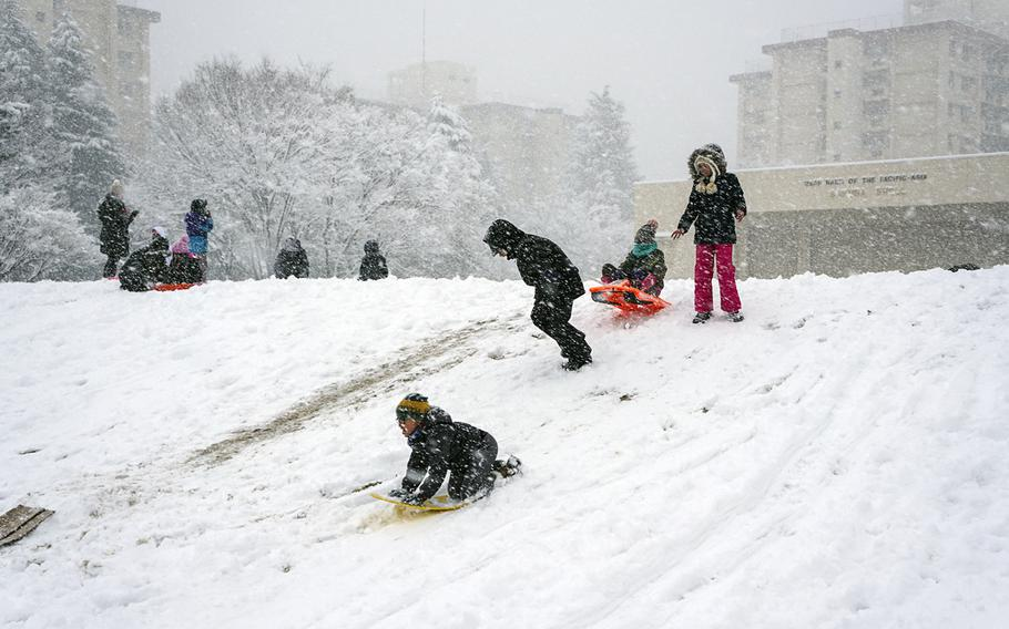 Children at Yokota Air Base play in the snow, which caused early closures at Camp Zama, Naval Air Facility Atsugi and Yokota on Jan. 22, 2018.