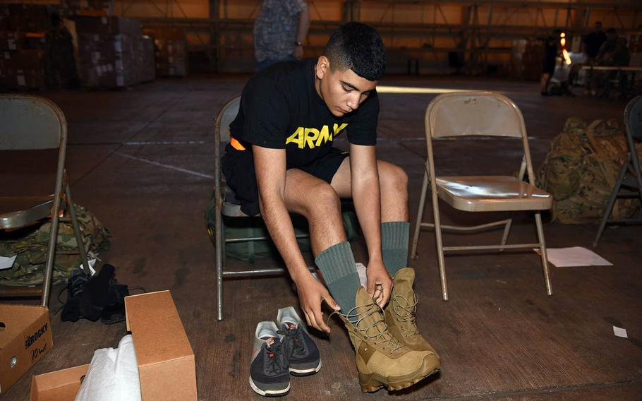 A soldier with the 25th Infantry Division in Hawaii pulls on a prototype of a jungle combat boot earlier this month. Soldiers will test the new boot and a hot-weather uniform for the next half-year in jungle conditions in Hawaii and Southeast Asia.