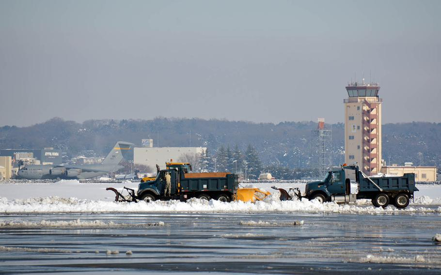 Snowplows work after more than 12 inches of snow fell at Yokota Air Base in western Tokyo, Tuesday, Jan. 23, 2018.