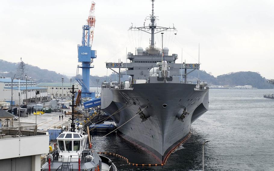 After 19 months in dry dock, the USS Blue Ridge sits pier side at Yokosuka Naval Base, Japan, Monday, Jan. 22, 2018.