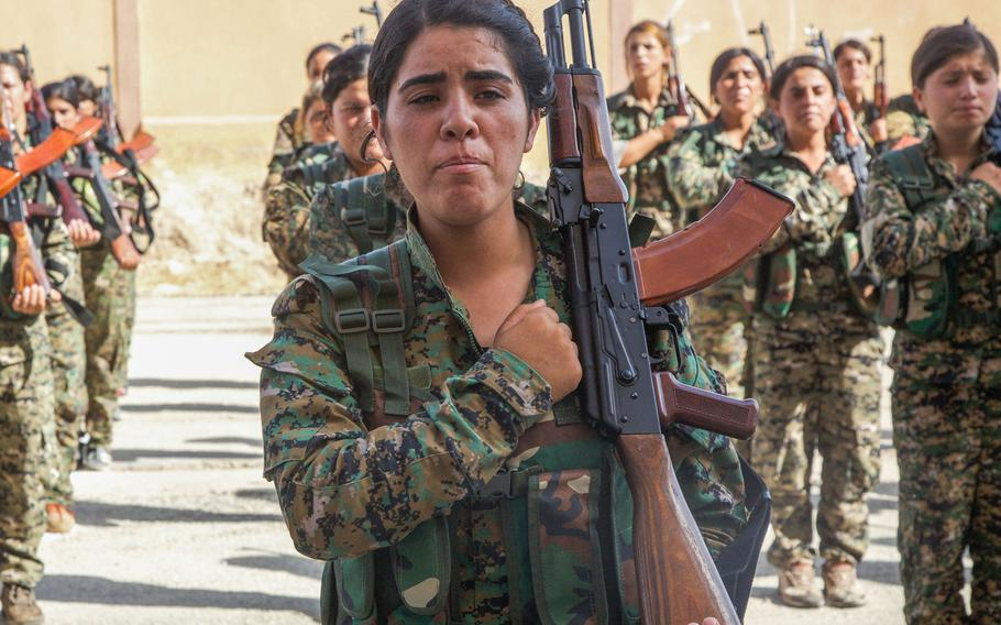 Syrian Democratic Force trainees stand in formation at their August graduation ceremony in northern Syria. U.S.-supported Kurdish troops make up a large segment of the SDF, which has angered NATO ally Turkey.