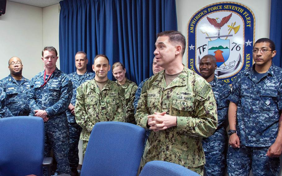 Rear Adm. Brad Cooper took command of Task Force 76 in Okinawa, Japan, Monday, Jan. 22, 2018.
