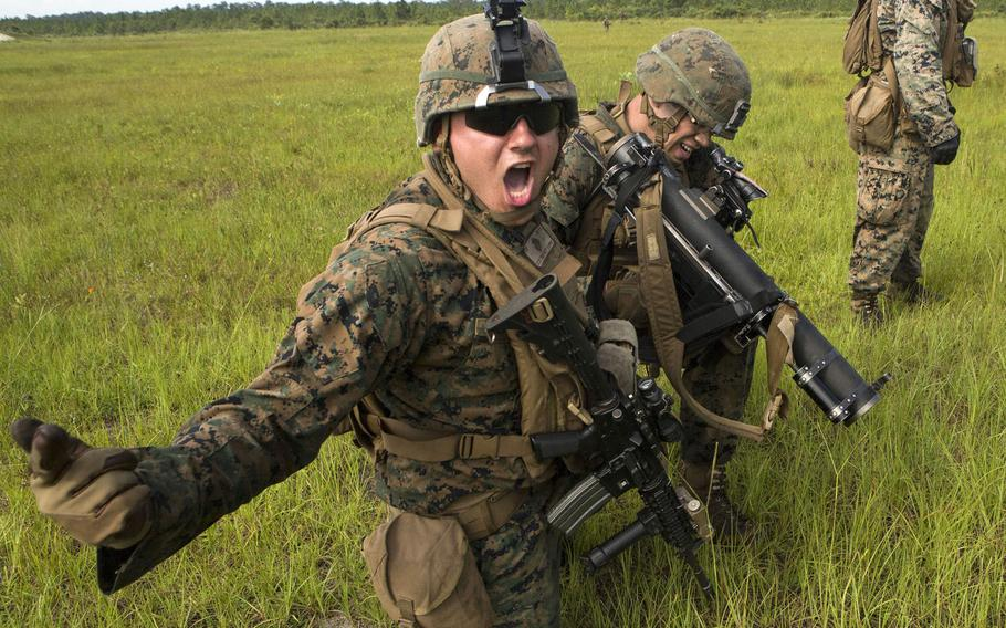 U.S. Marine Corps Lance Cpl. Charlie F. Delrio, infantry assaultman, with 2nd Battalion, 8th Marine Regiment, 2nd Marine Division, calls out commands during a live-fire range  on Camp Lejeune, N.C., June 15, 2017.
