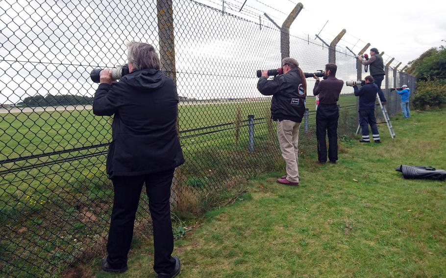 Aviation enthusiasts take photographs of an RAF Tornado taking off from RAF Lakenheath, England, near the base's viewing area, Oct. 3, 2017. People have legally taken footage of military operations in the United Kingdom from outside base fence lines since the 1950s.