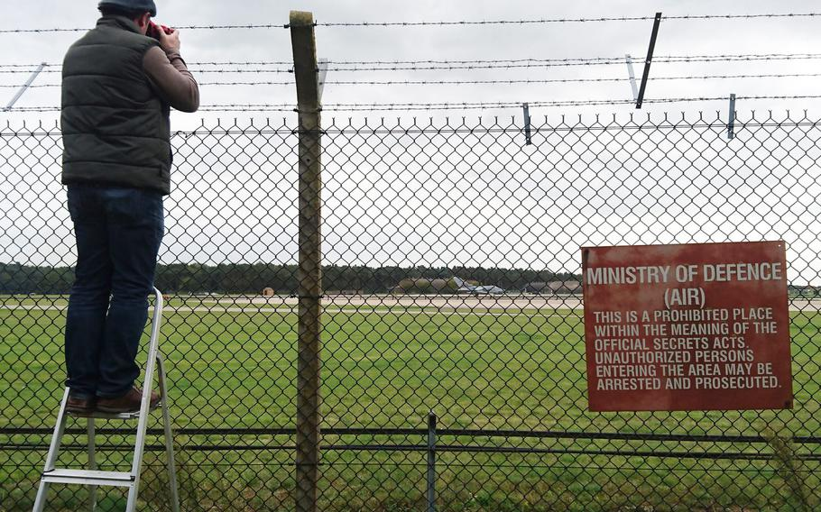 An aviation enthusiast photographs a RAF Tornado taking off from RAF Lakenheath, England, near the base's viewing area, Oct, 3, 2017.