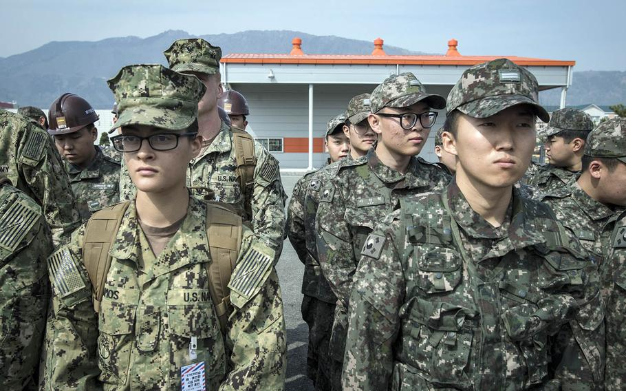 American and South Korean sailors listen to a safety briefing during exercise Foal Eagle in Jinhae, South Korea, March 13, 2017.