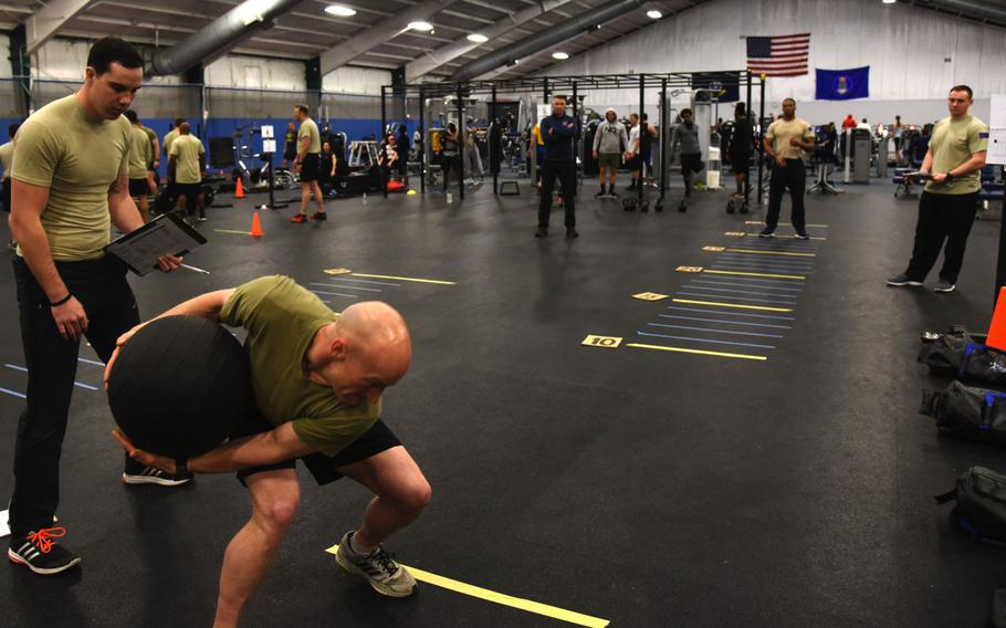 Senior Master Sgt. Kenneth Blakeney, second from left, launches a medicine ball at the fitness center at Joint Base Andrews, Md., Tuesday, Jan. 9, 2018. The Air Force began the introduction of Tier 2 physical training standards as more than 100 battlefield Airmen demonstrated new career-field-specific testing components.