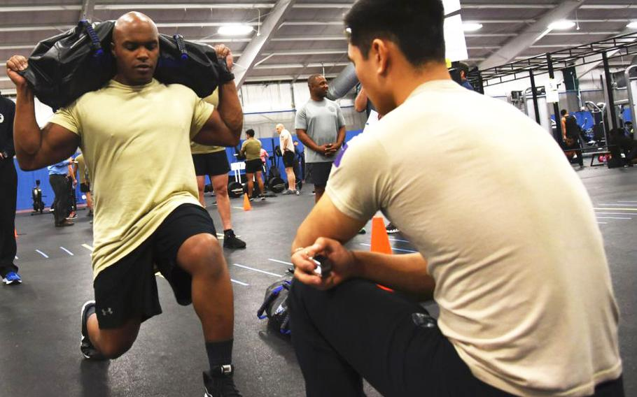 Master Sgt. Eric Rideaux, 9th Air Force, performs lunges during a fitness demonstration for the Air Force's special operations community at Joint Base Andrews, Md., Tuesday, Jan. 9, 2018.