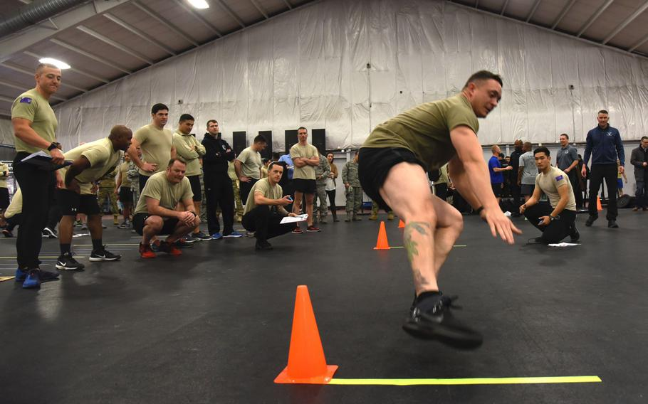 Master Sgt. Kyle Anderson, 3rd Air Support Operations Group, runs between two cones during a speed, strength and agility demonstration at Joint Base Andrews, Md., Tuesday, January 9, 2018. The Air Force began the rollout of Tier 2 physical training standards as more than 100 battlefield Airmen demonstrated new career field specific testing components.