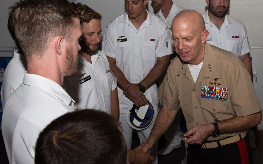 Lt. Gen. David Berger, Marine Forces Pacific commander, speaks with members of Australian Clearance Diving Team One after presenting a U.S. Meritorious Unit Commendation aboard the HMAS Adelaide in Sydney, Monday, Jan. 29, 2018.