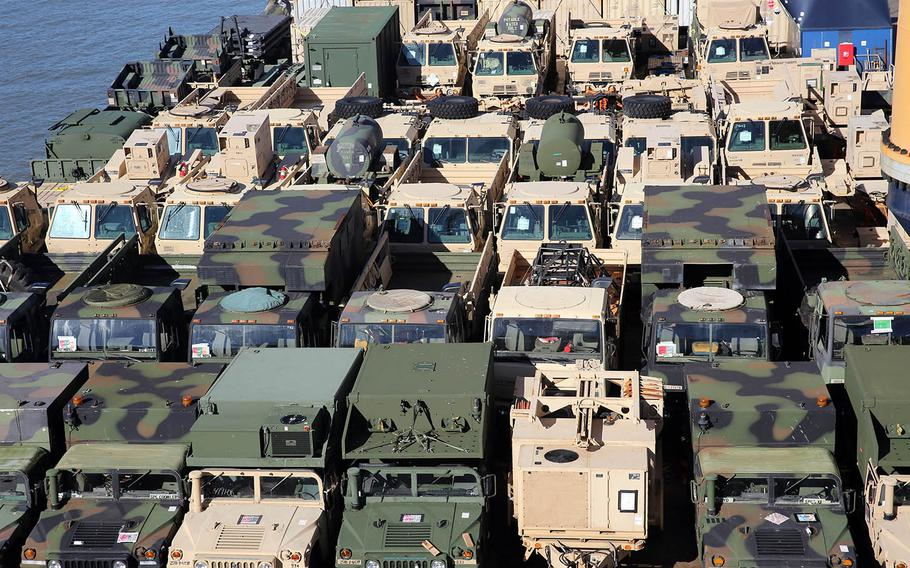 Dozens of military vehicles sit last spring on the top deck of heavy-lift vessel Ocean Jazz, which were used in the Talisman Sabre exercise in Australia as part of the Army's  Pacific Pathways.