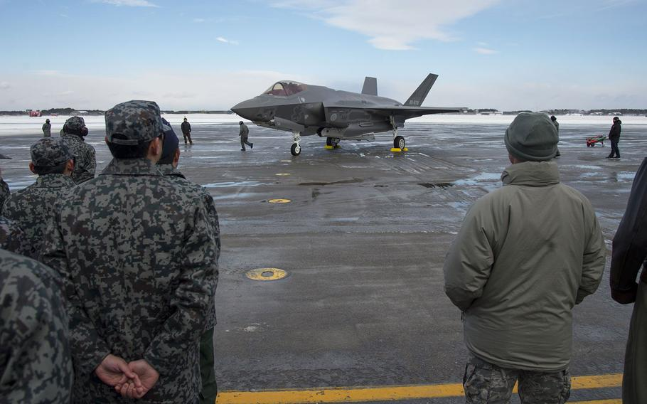 Japan Air Self-Defense Force members join 35th Fighter Wing and Naval Air Facility-Misawa leadership to watch Japan's first F-35A arrive at Misawa Air Base, Friday, Jan. 26, 2018.