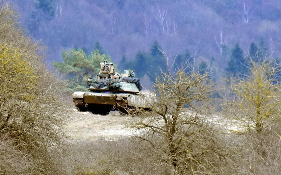 An M1A2 Abrams Tank is perched on a hill during the Allied Spirit VIII exercise in Hohenfels, Germany, Monday, Jan. 29.
