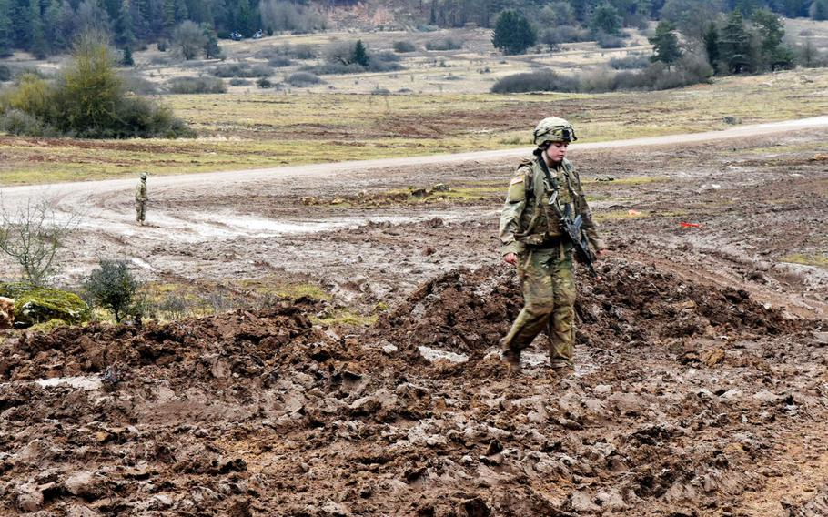 U.S. Army Spc. Rosa Bens walks through a field of mud during the Allied Spirit VIII exercise at Hohenfels, Germany, Monday, Jan. 29, 2018.