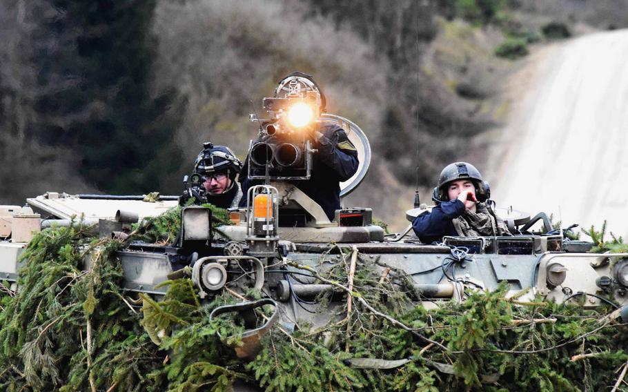 The enemy forces, in a training scenerio, signal to fellow soldiers using a spotlight, during the Allied Spirit VIII exercise in Hohenfels, Germany, Monday, Jan. 29, 2018.