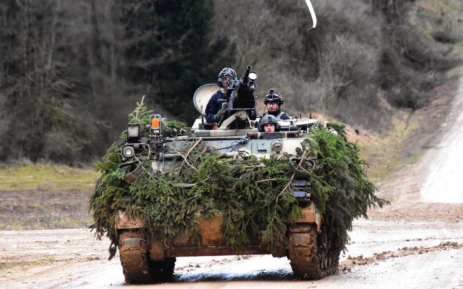 The enemy forces, in a training scenario, drive a modified M113-A3 vehicle to simulate a BMP armored personnel carrier during the Allied Spirit VIII exercise in Hohenfels, Germany, Monday, Jan. 29, 2018.