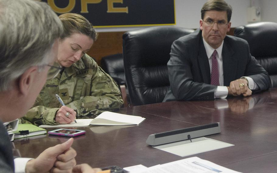 Secretary of the Army Mark Esper listens to a journalist's question in Wiesbaden, Germany, Monday, Jan. 29, 2018. Esper emphasized the need of the Army to prepare for ''high-end'' conflict against near-peer adversaries.