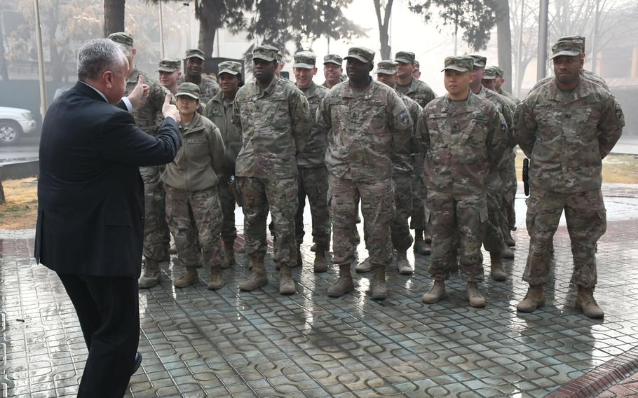 Deputy Secretary of State John J. Sullivan gives the thumbs-up to U.S. troops at NATO's Resolute Support headquarters in Kabul, Afghanistan, on Tuesday, Jan. 30, 2018.
