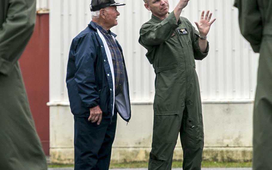 Lt. Col. Bryan Swenson chats with a World War II veteran last spring at Marine Corps Air Station Futenma, Okinawa.